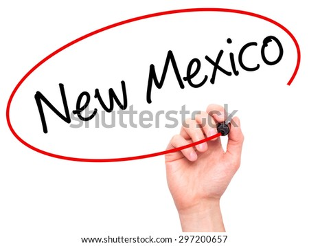 Man Hand writing New Mexico with black marker on visual screen. Isolated on white. Business, technology, internet concept. Stock Photo - stock photo