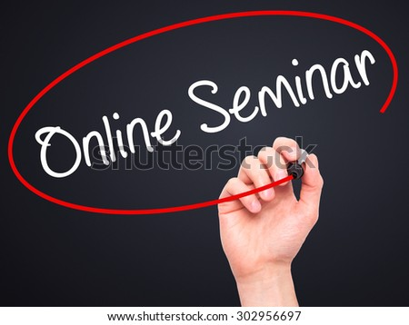Man Hand writing Online Seminar with black marker on visual screen. Isolated on black. Business, technology, internet concept. Stock Photo - stock photo