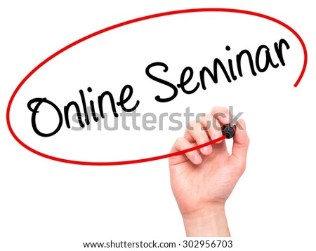 Man Hand writing Online Seminar with black marker on visual screen. Isolated on white. Business, technology, internet concept. Stock Photo - stock photo