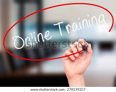 Man Hand writing Online Training with marker on transparent wipe board. Isolated on office. Business, internet, technology concept.  Stock Photo - stock photo
