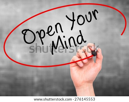 Man hand writing Open Your Mind with marker on transparent screen. Business, internet, technology concept. Isolated on grey. Stock Image - stock photo