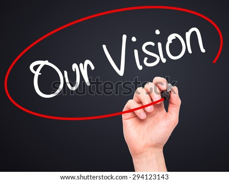 Man Hand writing Our Vision with black marker on visual screen. Isolated on black. Business, technology, internet concept. Stock Photo - stock photo