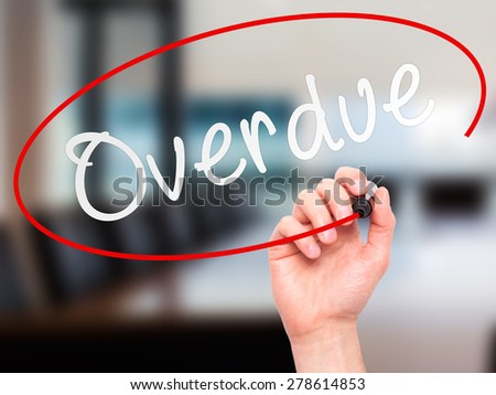 Man Hand writing Overdue with marker on transparent wipe board. Isolated on office. Business, internet, technology concept. Stock Photo - stock photo