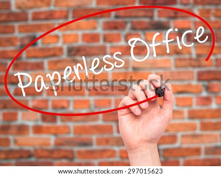 Man Hand writing Paperless Office  with black marker on visual screen. Isolated on bricks. Business, technology, internet concept. Stock Photo - stock photo