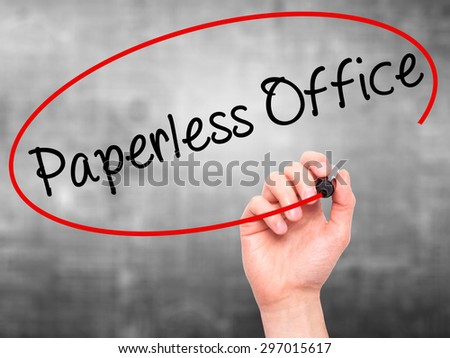 Man Hand writing Paperless Office  with black marker on visual screen. Isolated on grey. Business, technology, internet concept. Stock Photo - stock photo