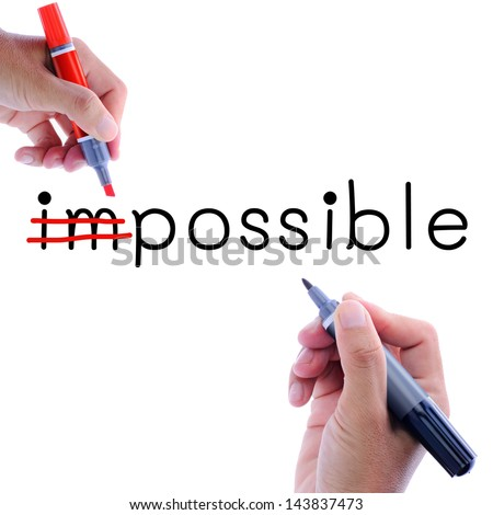 Man hand writing possible from impossible. Motivation concept - stock photo
