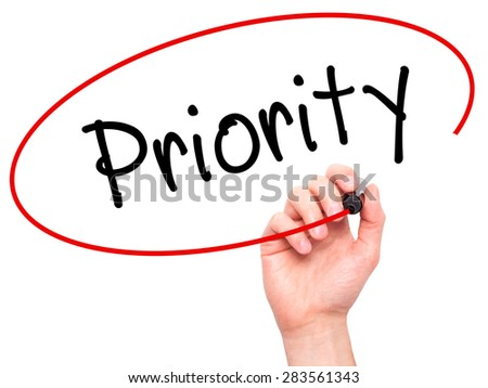 Man Hand writing Priority with marker on transparent wipe board. Isolated on white. Business, internet, technology concept. Stock Photo - stock photo