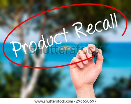 Man Hand writing Product Recall with black marker on visual screen. Isolated on nature. Business, technology, internet concept. Stock Photo - stock photo
