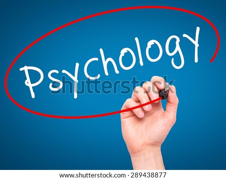 Man Hand writing Psychology with black marker on visual screen. Isolated on blue. Business, technology, internet concept. Stock Image - stock photo
