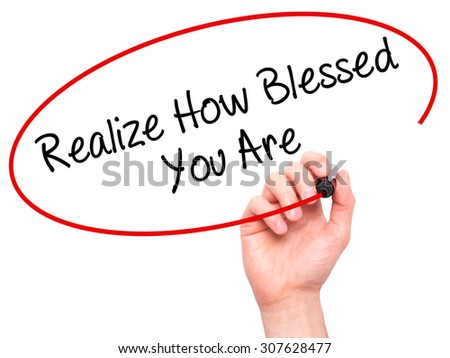 Man Hand writing  Realize How Blessed You Are  with black marker on visual screen. Isolated on white. Business, technology, internet concept. Stock Photo - stock photo
