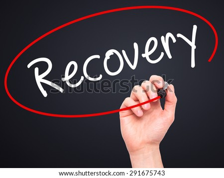 Man Hand writing  Recovery  with black marker on visual screen. Isolated on black. Life, technology, internet concept. Stock Image - stock photo