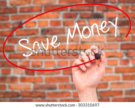 Man Hand writing Save Money with black marker on visual screen. Isolated on bricks. Business, technology, internet concept. Stock Photo - stock photo