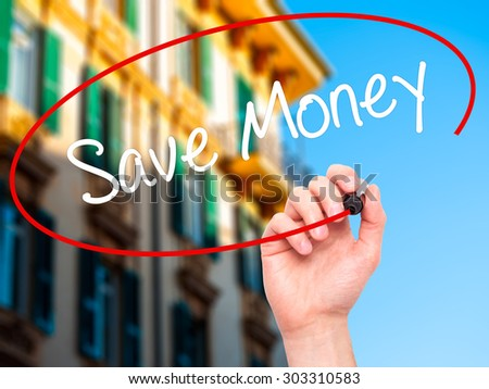 Man Hand writing Save Money with black marker on visual screen. Isolated on city. Business, technology, internet concept. Stock Photo - stock photo