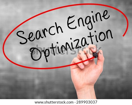 Man Hand writing Search Engine Optimization with black marker on visual screen. Isolated on grey. Business, technology, internet concept. Stock Image - stock photo