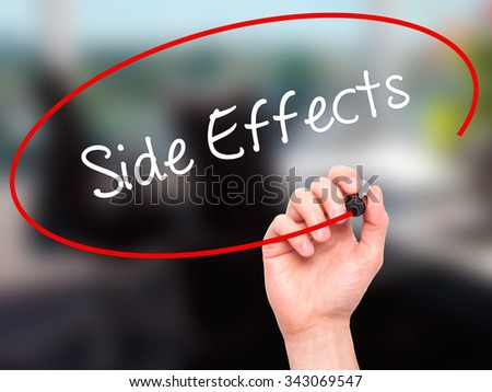 Man Hand writing Side Effects with black marker on visual screen. Isolated on office. Business, technology, internet concept. Stock Photo - stock photo