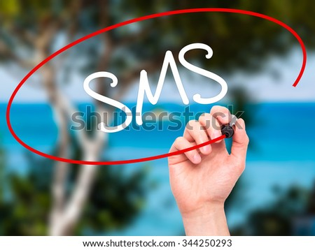 Man Hand writing  SMS (Short Message Service)  with black marker on visual screen. Isolated on background. Business, technology, internet concept. Stock Photo - stock photo