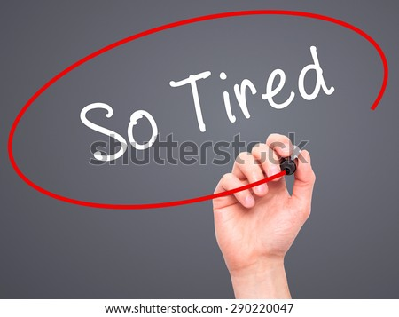 Man Hand writing So Tired with black marker on visual screen. Isolated on grey. Business, technology, internet concept. Stock Image  - stock photo