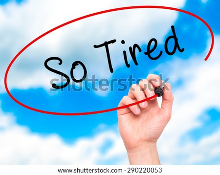 Man Hand writing So Tired with black marker on visual screen. Isolated on sky. Business, technology, internet concept. Stock Image  - stock photo