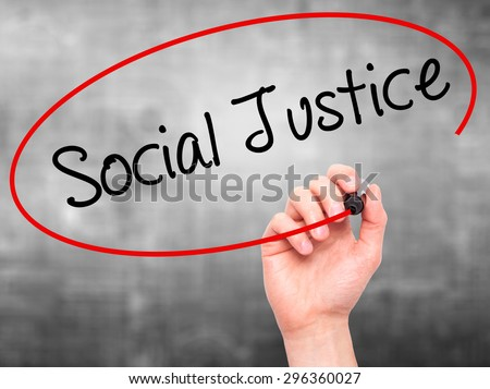 Man Hand writing Social Justice with black marker on visual screen. Isolated on grey. Business, technology, internet concept. Stock Photo - stock photo