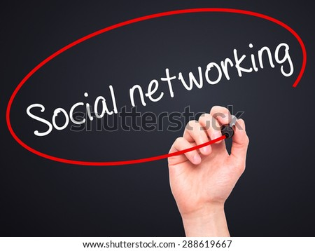 Man Hand writing Social networking with black marker on visual screen. Isolated on black. Business, technology, internet concept. Stock Image - stock photo