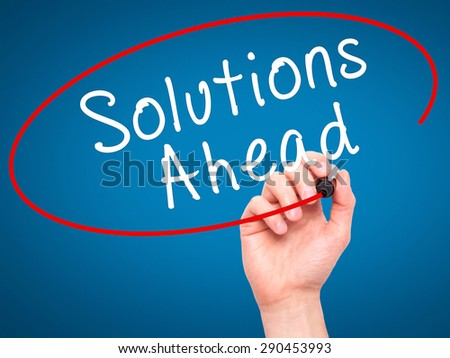 Man Hand writing Solutions Ahead with black marker on visual screen. Isolated on blue. Learn, technology, internet concept. Stock Image - stock photo