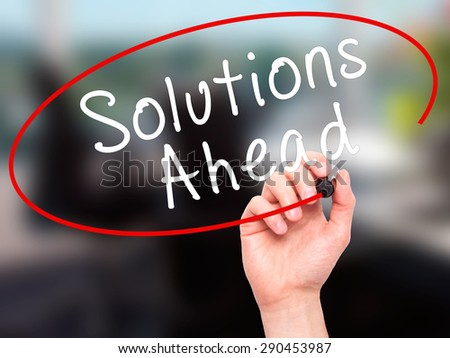 Man Hand writing Solutions Ahead with black marker on visual screen. Isolated on office. Learn, technology, internet concept. Stock Image - stock photo