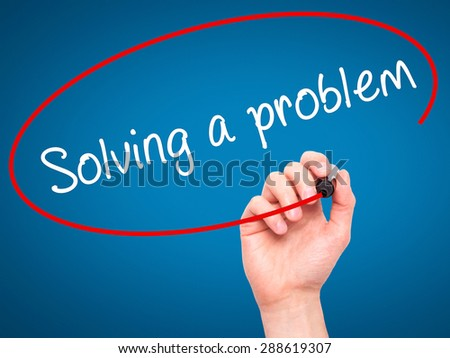 Man Hand writing Solving a problem with black marker on visual screen. Isolated on blue. Business, technology, internet concept. Stock Image - stock photo