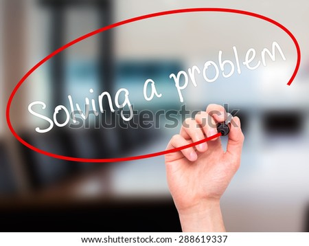 Man Hand writing Solving a problem with black marker on visual screen. Isolated on office. Business, technology, internet concept. Stock Image - stock photo