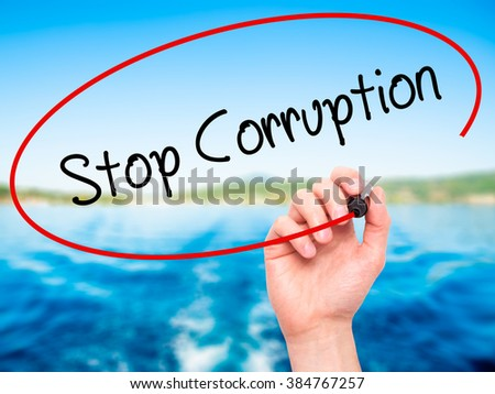 Man Hand writing Stop Corruption with black marker on visual screen. Isolated on background. Business, technology, internet concept. Stock Photo - stock photo