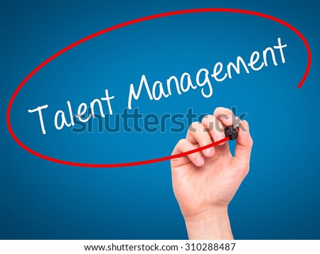 Man Hand writing Talent Management with black marker on visual screen. Isolated on blue. Business, technology, internet concept. Stock Photo - stock photo