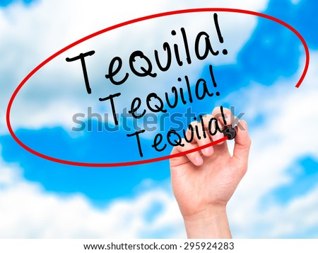 Man Hand writing Tequila with black marker on visual screen. Isolated on sky. Business, technology, internet concept. Stock Photo - stock photo
