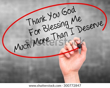 Man Hand writing Thank You God For Blessing Me Much More Than I Deserve with black marker on visual screen. Isolated on grey. Business, technology, internet concept. Stock Photo - stock photo