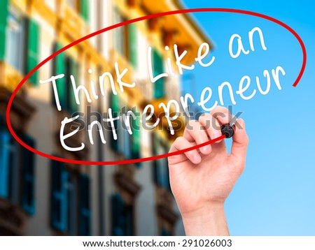 Man Hand writing Think Like an Entrepreneur with black marker on visual screen. Isolated on city. Business, technology, internet concept. Stock Image - stock photo