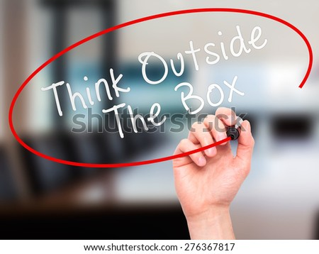 Man Hand writing Think Outside The Box with marker on transparent wipe board. Isolated on office. Business, internet, technology concept.  Stock Photo - stock photo
