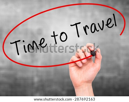 Man Hand writing Time to Travel with black marker on visual screen. Isolated on grey. Business, technology, internet concept. Stock Image - stock photo