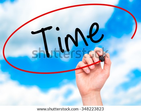 Man Hand writing Time with black marker on visual screen. Isolated on background. Business, technology, internet concept. Stock Photo - stock photo