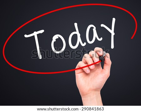 Man Hand writing Today with black marker on visual screen. Isolated on black. Business, technology, internet concept. Stock Image - stock photo