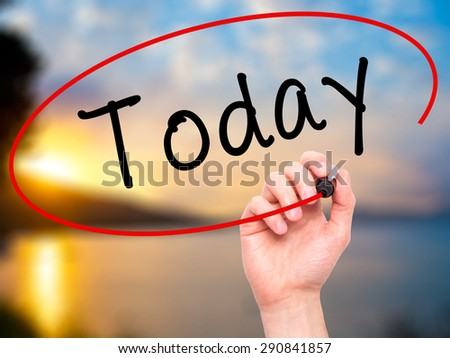 Man Hand writing Today with black marker on visual screen. Isolated on nature. Business, technology, internet concept. Stock Image - stock photo