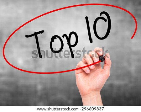 Man Hand writing Top 10 with black marker on visual screen. Isolated on grey. Business, technology, internet concept. Stock Photo - stock photo