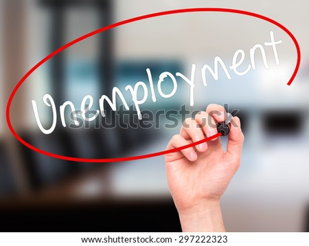 Man Hand writing  Unemployment with black marker on visual screen. Isolated on office. Business, technology, internet concept. Stock Photo - stock photo