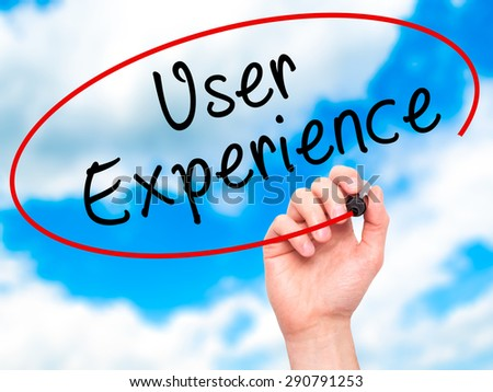 Man Hand writing User Experience with black marker on visual screen. Isolated on sky. Business, technology, internet concept. Stock Image - stock photo