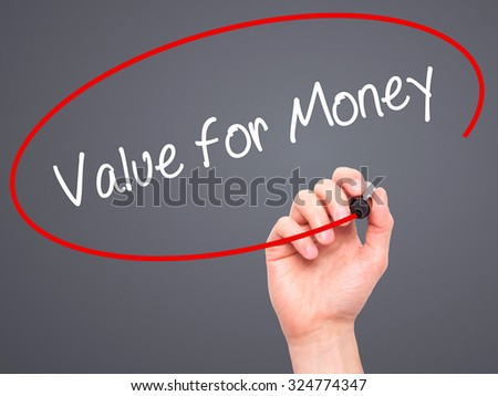 Man Hand writing Value for Money with black marker on visual screen. Isolated on grey. Business, technology, internet concept. Stock Photo - stock photo