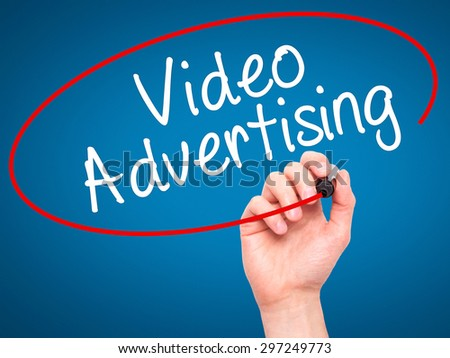 Man Hand writing Video Advertising with black marker on visual screen. Isolated on blue. Business, technology, internet concept. Stock Photo - stock photo