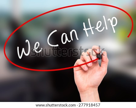 Man hand writing We Can Help on visual screen. Business,help, internet, technology concept. Isolated on office. Stock Photo - stock photo