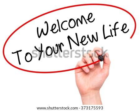 Man Hand writing Welcome To Your New Life with black marker on visual screen. Isolated on background. Business, technology, internet concept. Stock Photo - stock photo