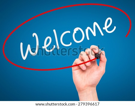 Man Hand writing Welcome with marker on transparent wipe board. Isolated on blue. Business, internet, technology concept. Stock Photo - stock photo
