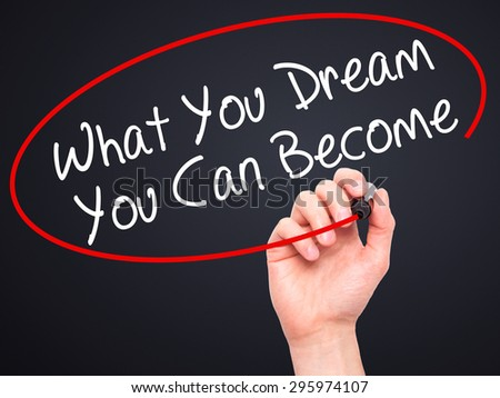 Man Hand writing What You Dream You Can Become with black marker on visual screen. Isolated on black. Business, technology, internet concept. Stock Photo - stock photo