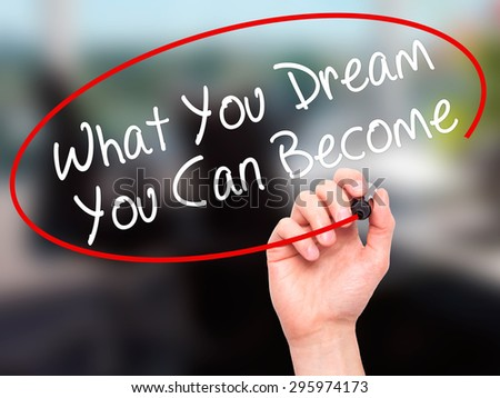 Man Hand writing What You Dream You Can Become with black marker on visual screen. Isolated on office. Business, technology, internet concept. Stock Photo - stock photo