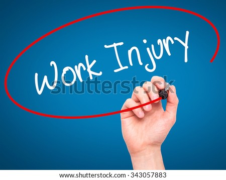 Man Hand writing Work Injury with black marker on visual screen. Isolated on blue. Business, technology, internet concept. Stock Photo - stock photo