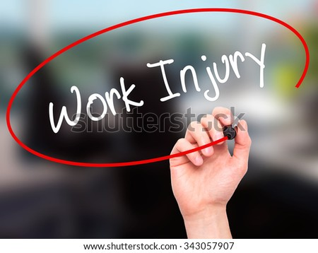 Man Hand writing Work Injury with black marker on visual screen. Isolated on office. Business, technology, internet concept. Stock Photo - stock photo